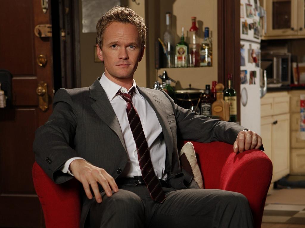 Barney wearing a suit