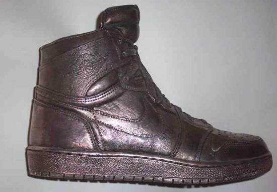 Air Jordan 1 silver shoe seen on a grey background