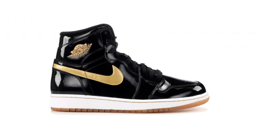 Air Jordan 1 black and gold seen on a white background