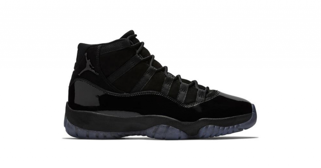 Air Jordan 11 blackout sneaker seen on a white font