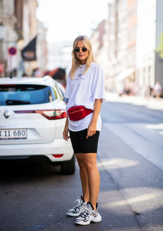Girl wearing a red Fanny Pack and a white oversized tee
