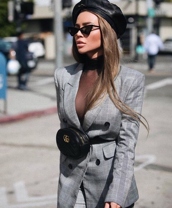 Girl wearing a gray blazer with a Fanny Pack